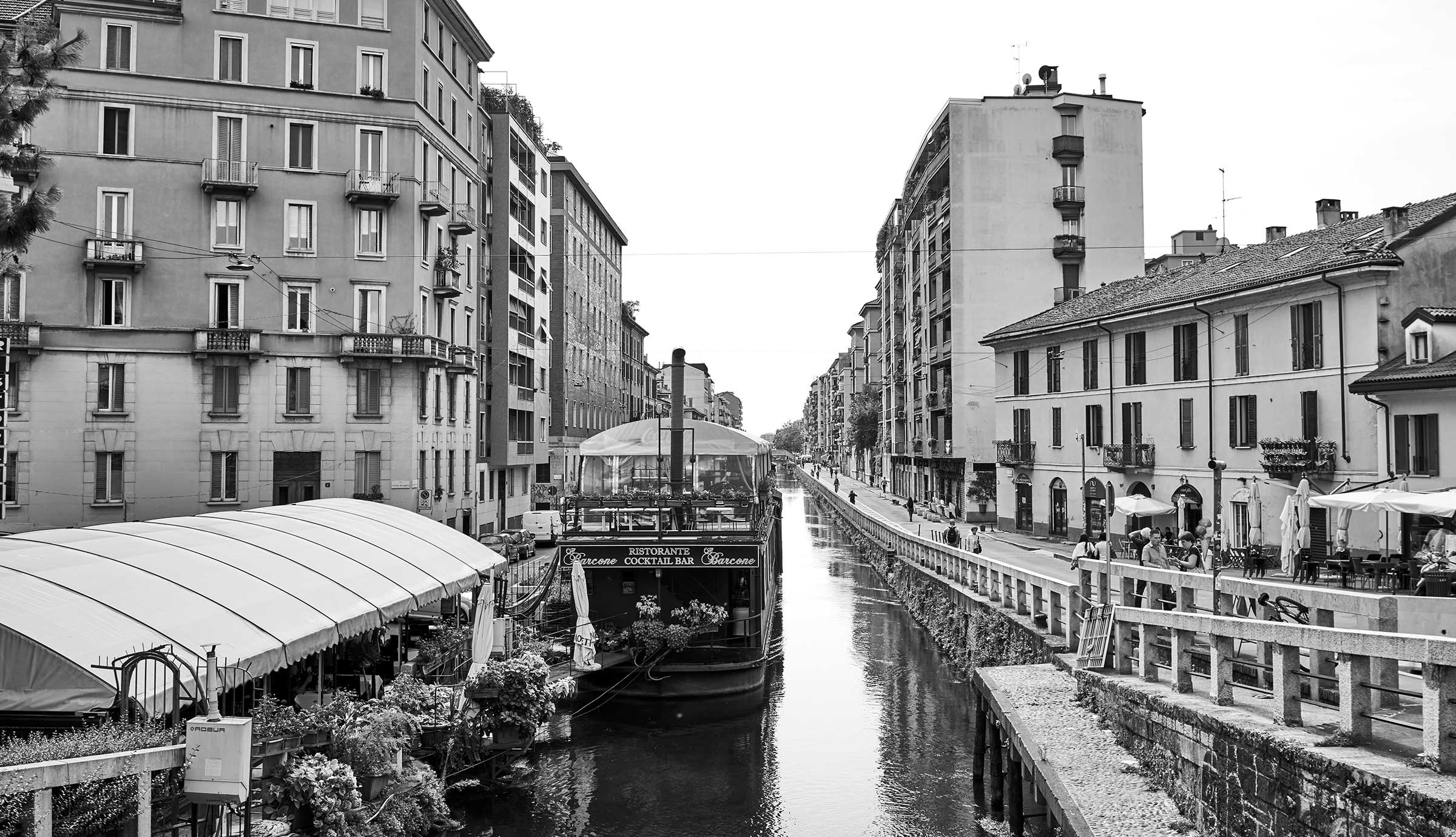 Milan scenery with buildings and boat along a canal